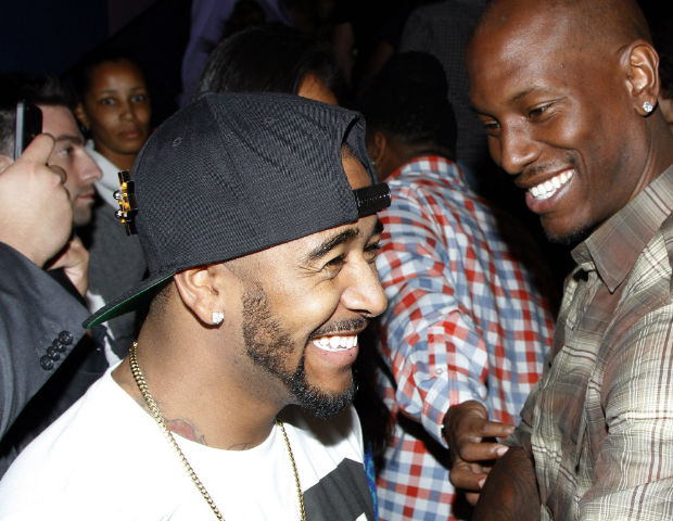 Omarion and Tyrese hug it out after the private