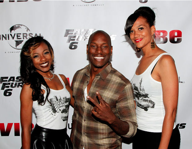 Tyrese shows the ladies some love while showing off his pearly whites for the media.