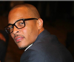 t.i. in suit and glasses