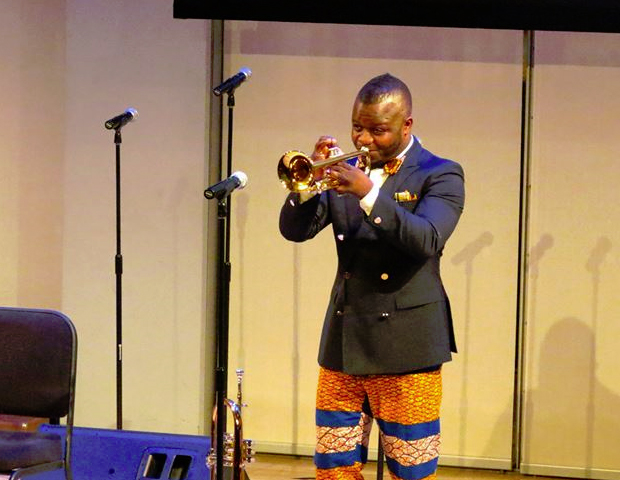 A trumpet player from Akroft & Co Live shows off his skills.