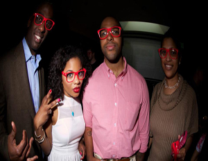 Urban Delivery founders Adrienne Sheares and Ron Cade (center) pose with guests at their app preview party in May (Image: Source)