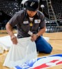 man-putting-nba-logo-on-floor