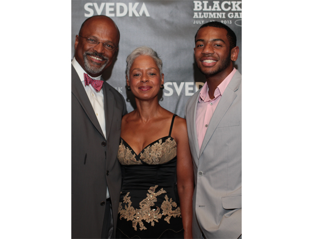 Surgeon and honoree Dr. Bernard Rawlins is pictured with his wife, Debra, and son Bernard III