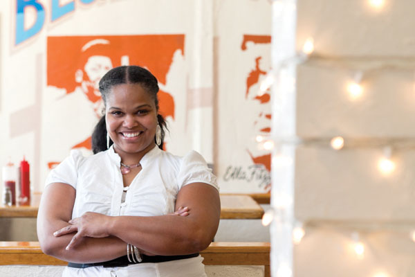Tamearra Dyson stands in her Souley Vegan Restaurant