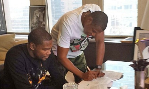 Kevin Durant Instagrammed a photo of he and Jay-Z signing a contract for Roc Nation Sports.