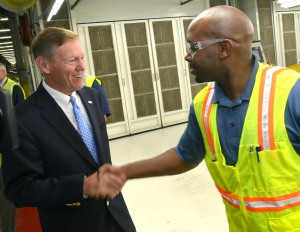Alan Mulally, Ford President and CEO, celebrates with team members during the Fusion Job One event at Flat Rock Assembly Plant.