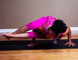 black woman demostrating yoga pose