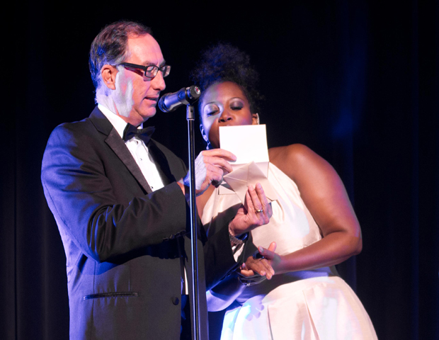 Robert Brunner of Arik Airlines, a corporate sponsor for the event, presents an award with actress Ebbe Bassey.