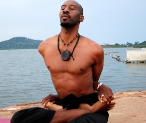 Black Yogi Pablo Imani in full lotus pose