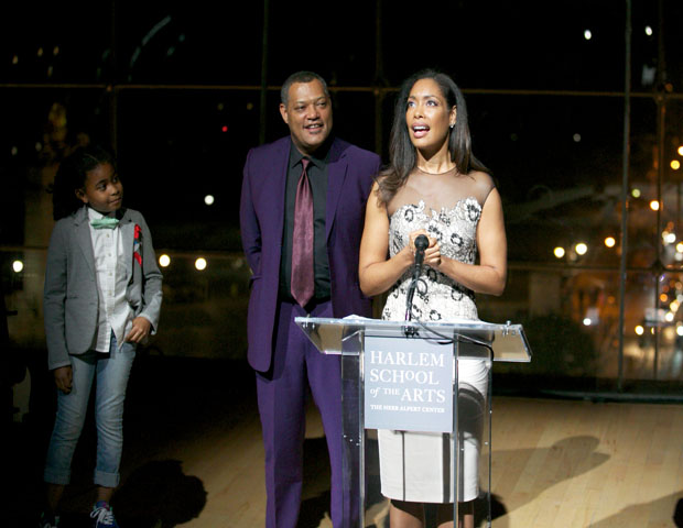Hollywood power couple Laurence Fishburne and Gina Torres accept the Visionary Artist award.