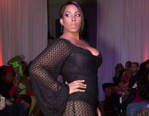 plus size black model in Mad Couture Design