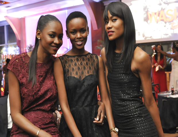 Oluchi Onweagba, international supermodel and founder of OModel Africa, far right, and Flaviana Matata, Miss Universe 2007, center, came out to support the event along with friends.