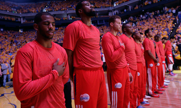 Race and Beyond: Calling Foul Against Racism in the NBA