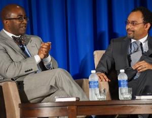 Black Enterprise's Alfred Edmond Jr chats with Shark Tank executive Rodney S. Sampson. (Image: Patrick Austin/Black Enterprise)