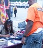 """Bern Nadette Stanis of """"Good Times"""" fame signs a T-shirt for a fan."""