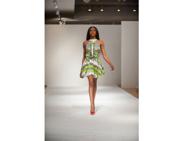 Hazel Eki Aggrey-Orleans of Eki Orleans: Eki Orleans' pieces were brightly colored and modern in how she combined materials together in a way that uniquely molds it together. She showcased dresses and a bikini.