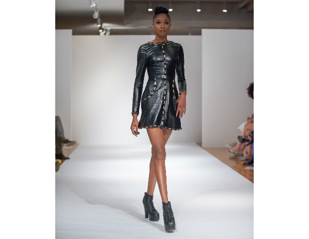Pieces by Anaba Wisdom Chidiebube of Weize Dhurm Franklyn were sleek yet elegantly show off the woman's body in a way that has the traditional meeting modernity. His pieces were highly detailed in how the pieces were form fitting, long or short, elegant and detailed with gold.