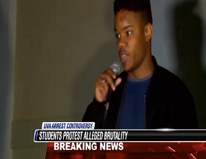 Image: Student Martese Johnson speaking at the protest that erupted after his bloody arrest (NBC 12 News)