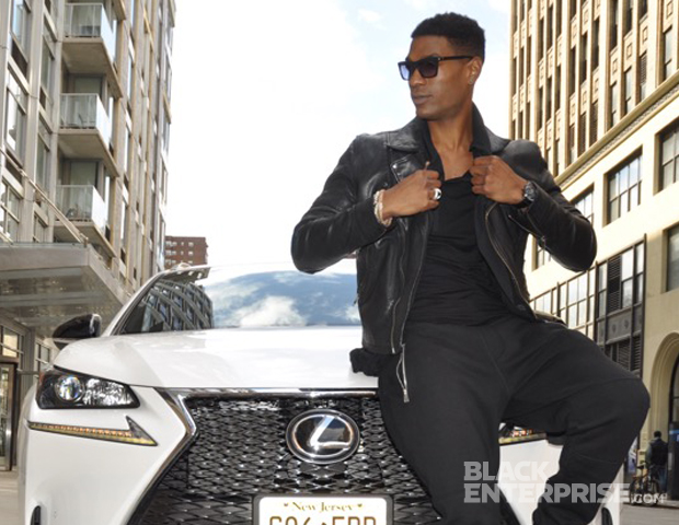 Model Bobby Roache strikes a pose with the sporty, chic vehicle.