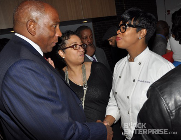 """Boss moment: Chef Kimberly VanKline and Black Enterprise President and CEO Earl """"Butch"""" Graves."""