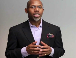 Image: Rev. Cedric Harmon, Co-director Many Voices (youtube)