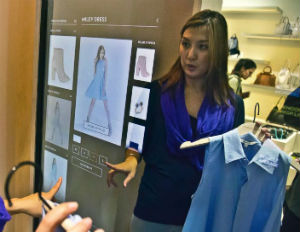 [VIDEO] Luxury Retailers Add 'SMART' Mirrors to Enhance Fitting Room Experience