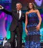 President Obama and First Lady Michelle Obama greet the audience during the Phoenix Awards at the 2015 CBCF conference.
