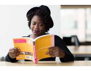 Woman studying tech book