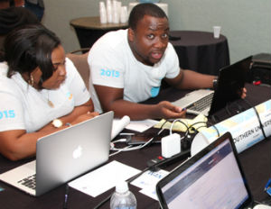 EJ looks up while conferring with his team at the BE Smart Hackathon. (Image: File)