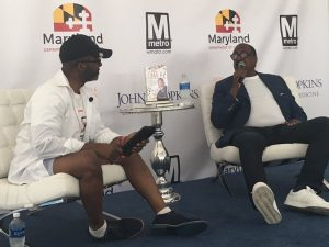 Knowles (right) breaks down the lessons he learned on the path to success. (Image: Baltimore African American Festival)