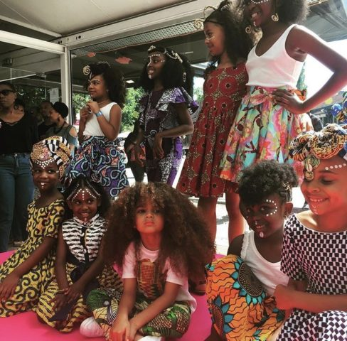 Farouk James pictured along side of other natural hair models